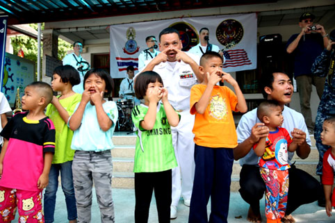 Children living with HIV/AIDS from The Camillian Social Center Rayong BEING ENTERTAINED BY THE UAS 7TH FLEET BAND