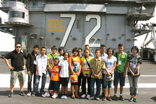 Children living with HIV/AIDS from The Camillian Social Center Rayong having a tour of  the USS ABRAHAM LINCOLN.