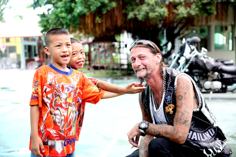 Germium Motor Cycle came to visit the children of the Camillian Social Center Rayong who are living with HIV/AIDS.