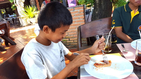 Children living with HIV/AIDS from The Camillian Social Center Rayong having a special lunch in Pattaya