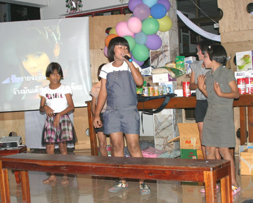 Children living with HIV/AIDS bring in 2011 with a lot of smiles at the Camillian social center rayong thailand