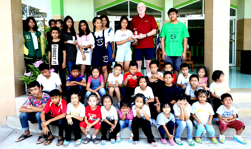 Children living with HIV/AIDS from The Camillian Social Center Rayong having a day out with RON SMALL.