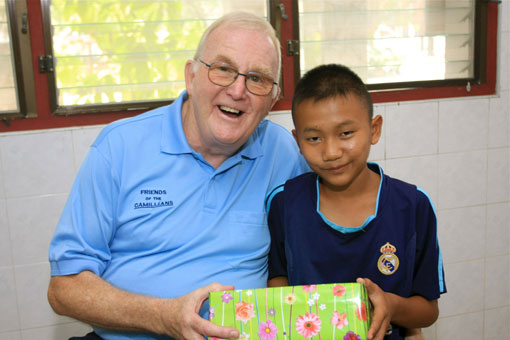 Children living with HIV/AIDS from The Camillian Social Center Rayong having a birthday party with Steve Williams.
