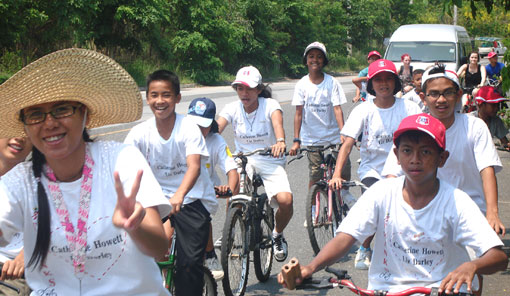 Children with HIV/AIDS cycling for health and doing a public service by cleaning the rubbish from their local beach