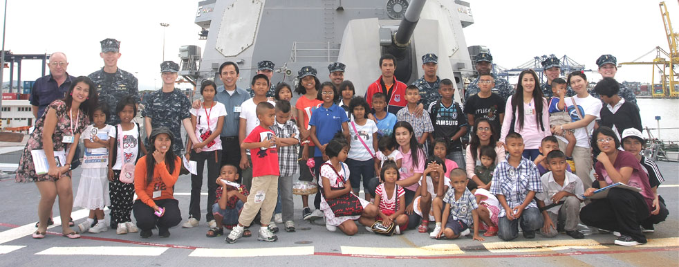 Children living with HIV/AIDS from The Camillian Social Center Rayong having a tour of Captain Scott Tait's ship the USS Mustin.